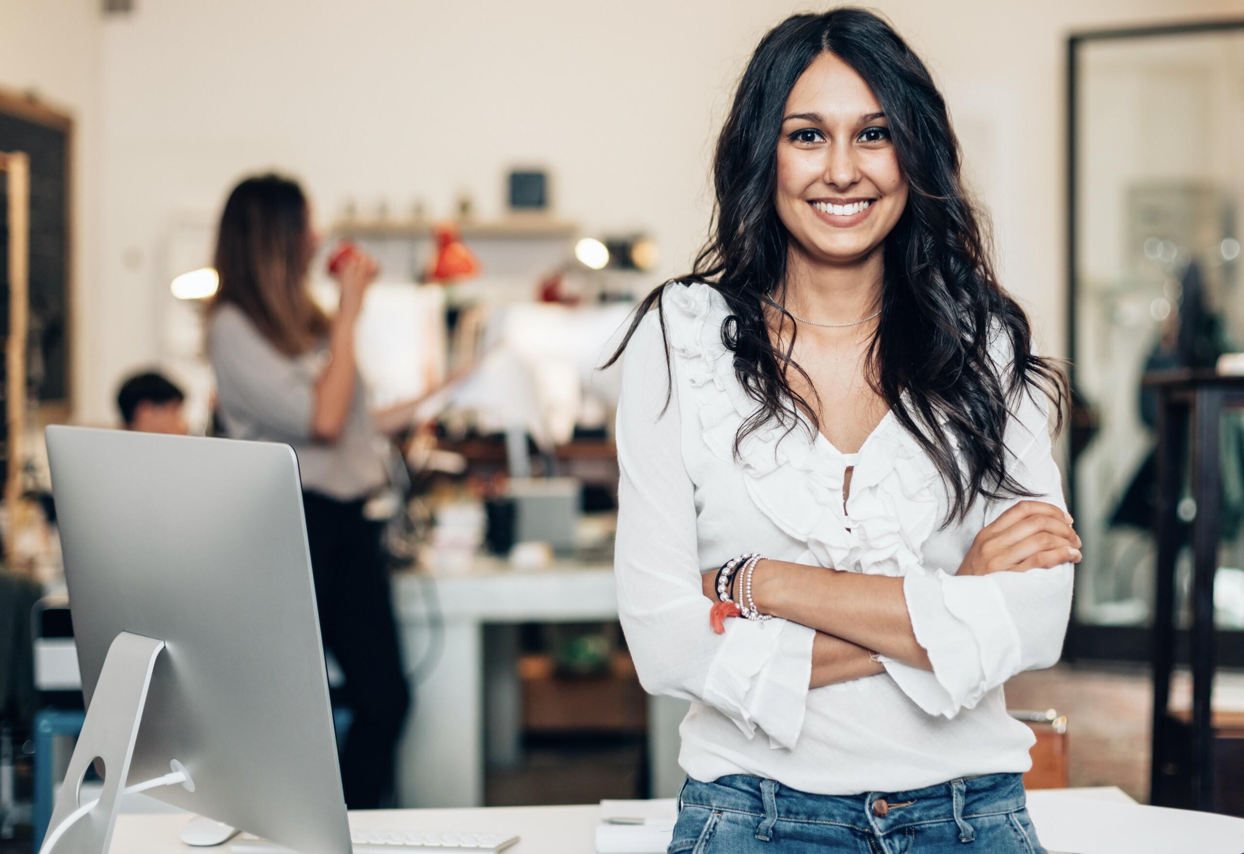 digital marking agency Nottingham girl smiling at desk